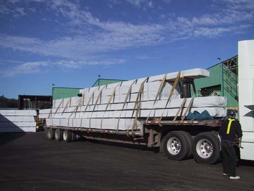 70ft lumber product being loaded on to a truck.
